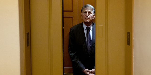 """Senator Joe Manchin, a Democrat from West Virginia, stands in an elevator in the Senate Subway of the U.S. Capitol in Washington, D.C., U.S., on Thursday, May 27, 2021. Manchin said he has """"planted my flag"""" at keeping the Senate filibuster at 60 votes but appeared open to potential changes to weaken the minority protection during a leaked call with an activist group and its fundraisers. Photographer: Stefani Reynolds/Bloomberg via Getty Images"""