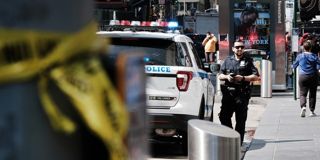 Police patrol in Times Square following another daytime shooting in the popular tourist destination on June 28, 2021 ニューヨーク市で.