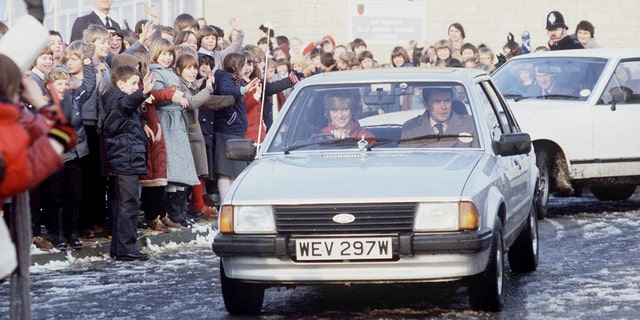 Diana Driving her car to a school visit with police bodyguard Graham Smith.