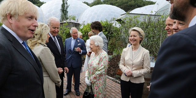 Britain's Queen Elizabeth II speaks to US President Joe Biden and his wife Jill Biden during reception with the G-7 leaders at the Eden Project in Cornwall, England.