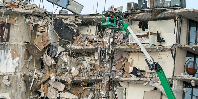 Rescue workers survey a wing of a partially collapsed 12-story beachfront condo building, June 25, 2021, in Surfside, Fla.Xxx 062521 Building Collapse 01 Jpg Usa Fl