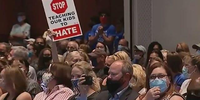 Loudoun school board meeting erupts as parents, educators condemn decision to put teacher Tanner Cross on leave