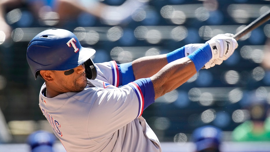 Khris Davis DFA'd by Rangers, who want look at young players
