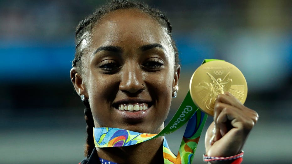 Olympic champ Rollins-McNeal banned 5 years in doping case