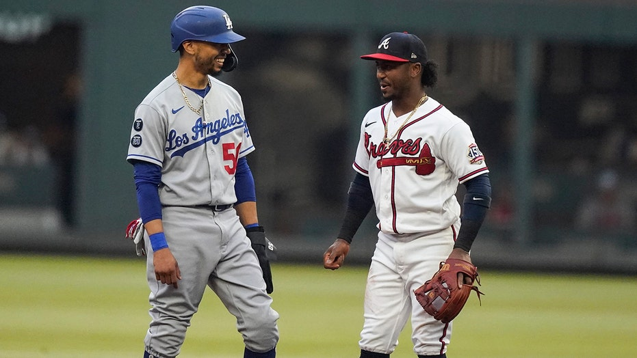 Albies, Almonte power Braves past Dodgers in 6-4 win