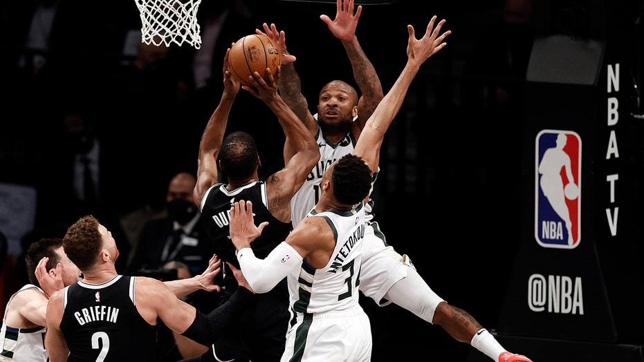 Durant, Irving carry Nets in opener after Harden hurt
