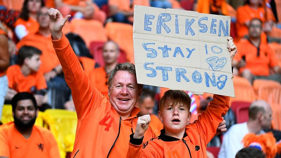 Fans in Amsterdam show support for Eriksen