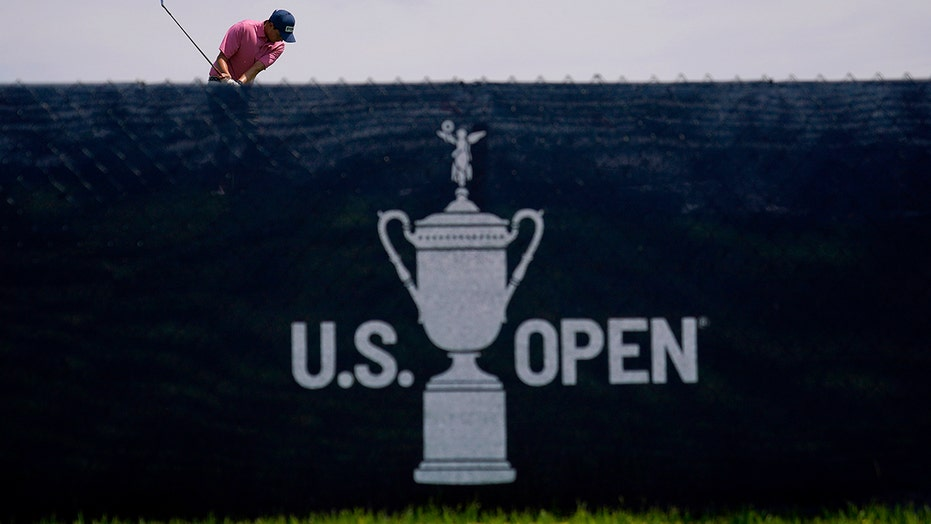 US Open male 'streaker' takes a swing on course before tackled by police