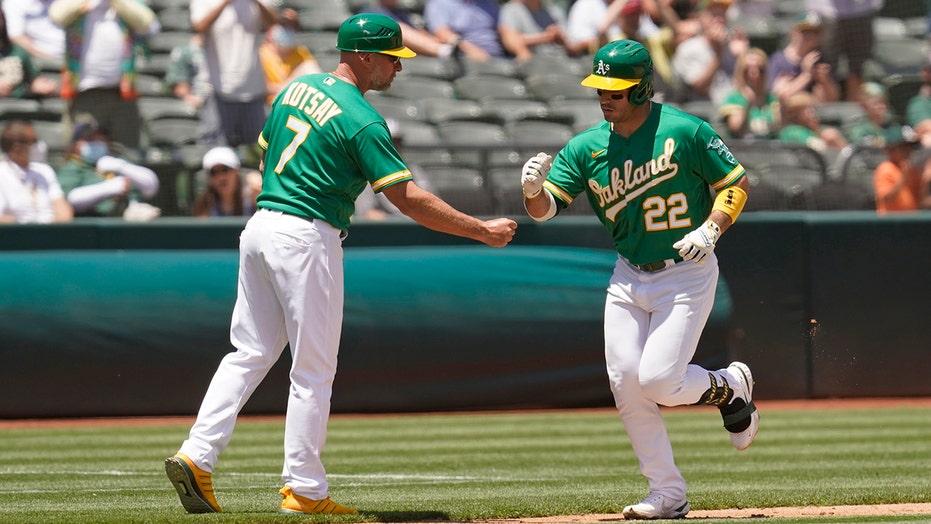 Laureano HR, nifty catch in return, streaking A's top Angels