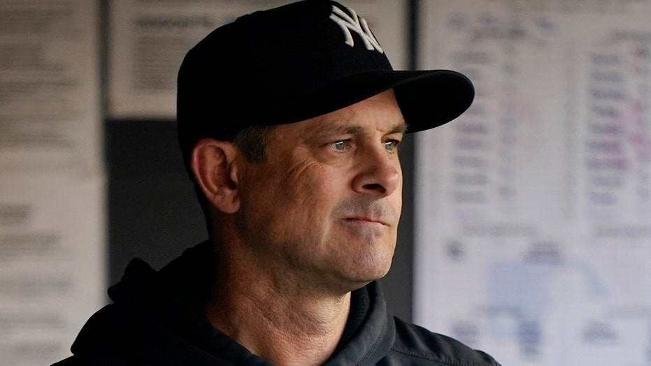 Boone returns on 3-year contract, Yankees demand success