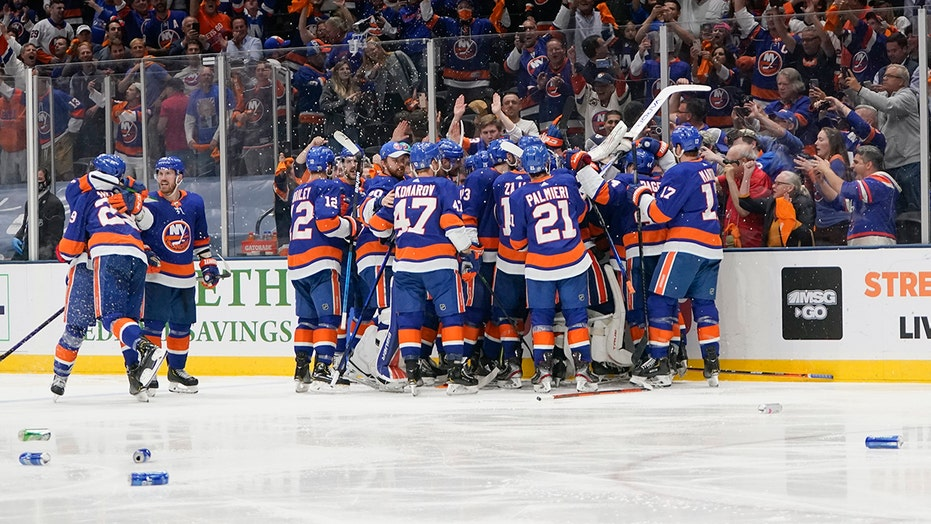 Islanders fans litter ice with beer cans after team's thrilling OT victory over Lightning