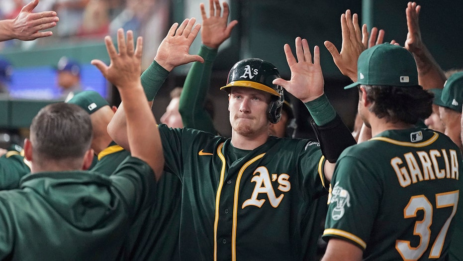 Athletics race to large, early lead, defeat Rangers 13-6