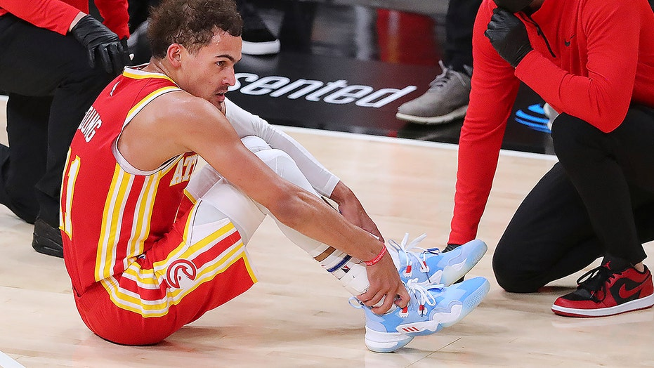 Hawks' Trae Young injures ankle after stepping on ref's foot in 'freaky accident'
