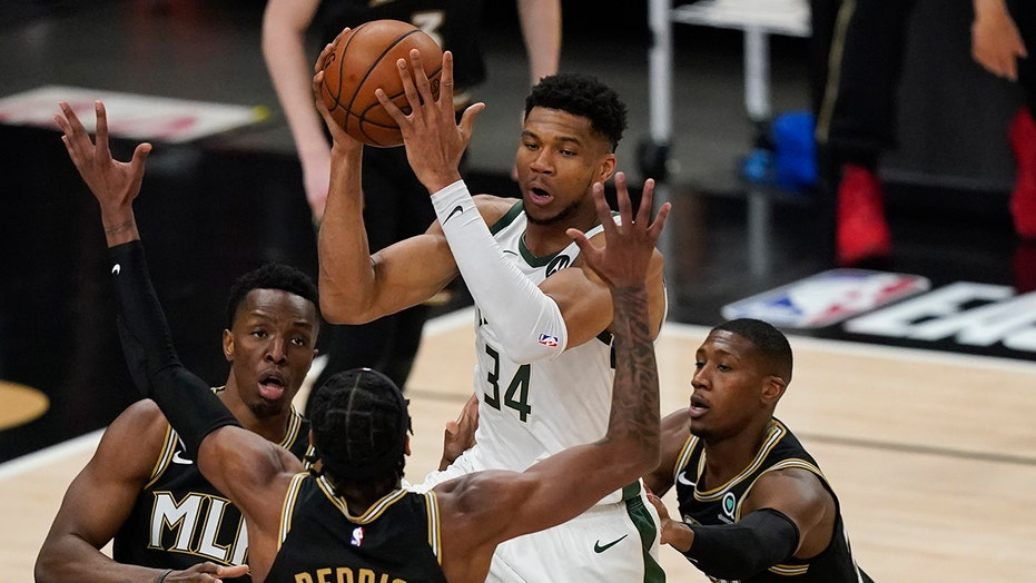 Bucks' Giannis Antetokounmpo appears to suffer knee injury, leaves raucous crowd silent