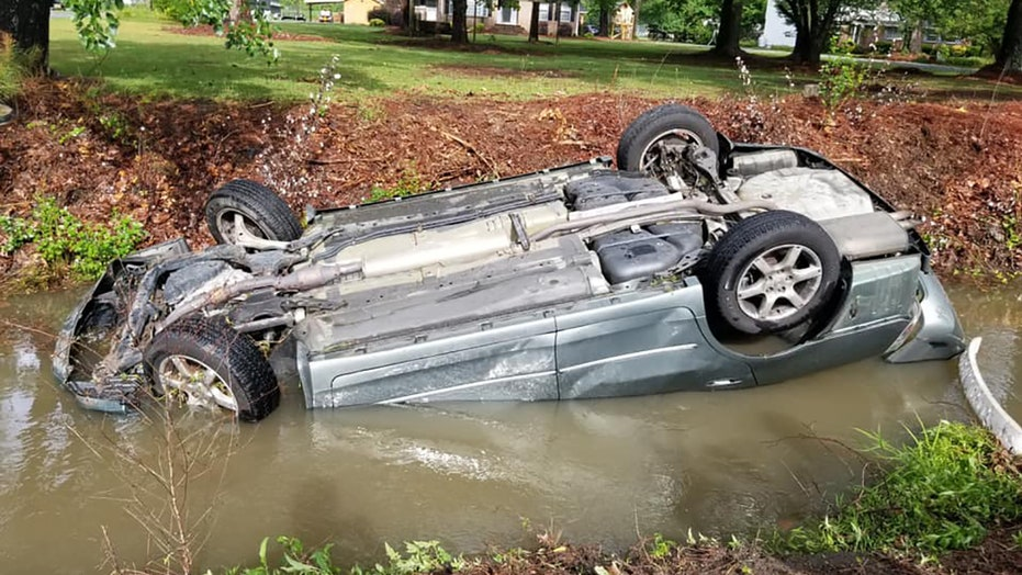 North Carolina police officers hailed as heroes after rescuing woman from overturned, submerged vehicle