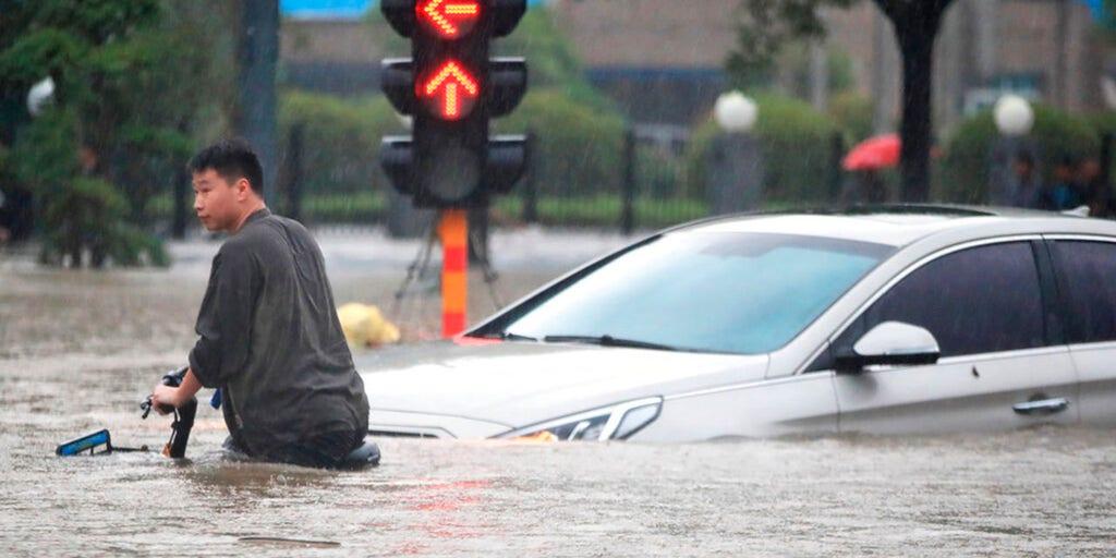China flooding kills 12, turns streets into rivers