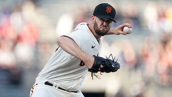 Wood goes 7 to win 8th, Giants beat Cardinals 5-2