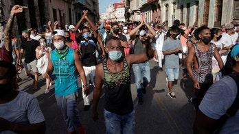 Biden praises Cuban protesters after Cuba president accuses US of funding demonstrators