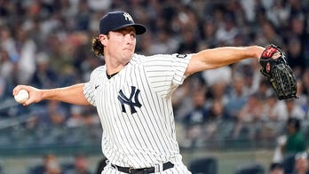 Cole, Yankees withstand rain to beat Red Sox 3-1