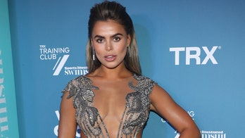 SI Swimsuit model Brooks Nader celebrates new issue by eating Popeyes chicken while rocking nearly nude gown