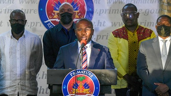Official: Haiti's interim prime minister to step down