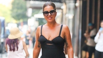 Lady Gaga turns heads in form-fitting black dress and matching platform heels in New York City