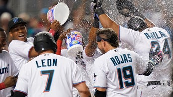 Aguilar's 3-run HR in 9th sends Marlins past Dodgers 9-6