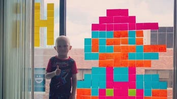 5-year-old fighting cancer uses sticky note art to make friends through hospital window