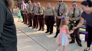 Arizona deputies escort late officer's daughter to first day of school