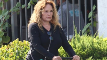 'Dukes of Hazzard' star Catherine Bach enjoys a stroll with her 'puppies' in Los Angeles