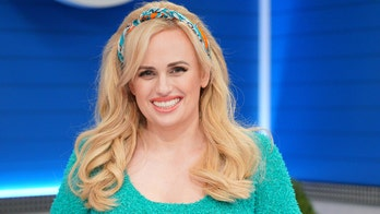 Rebel Wilson tells fans 'it's never too late to improve yourself' while posing in red hot swimsuit