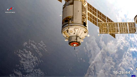 Russian lab module docks with space station after 8-day trip