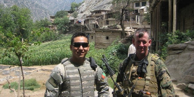 Edwards (right) and Quadratullah, the interpreter who was the first one to reach him the day they were ambushed. Kamu Village, Nuristan Province. (Credit: Ty Edwards)