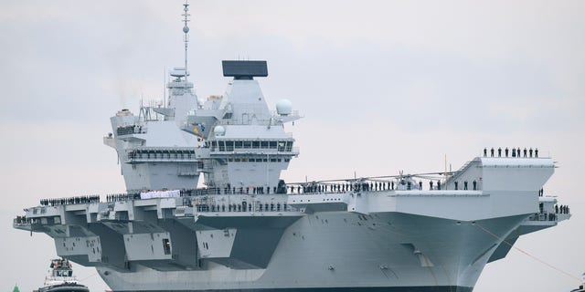 The HMS Queen Elizabeth supercarrier heads into port on August 16, 2017 in Portsmouth, England. The HMS Queen Elizabeth is the lead ship in the new Queen Elizabeth class of supercarriers. Weighing in at 65,000 tons she is the largest war ship deployed by the British Royal Navy. (Photo by Leon Neal/Getty Images)