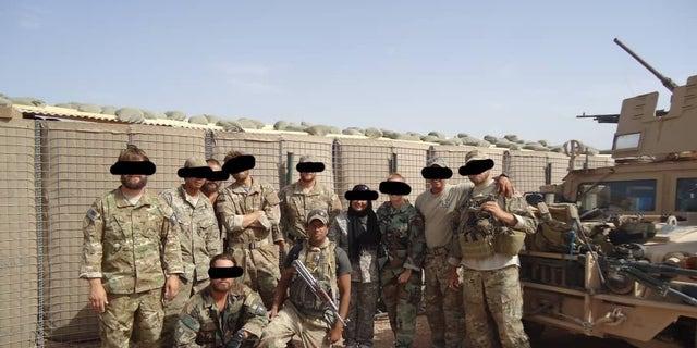 Moneer with Green Beret team members in 2010.