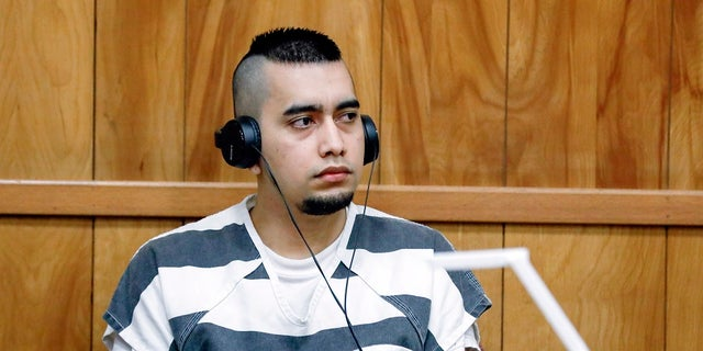In this July 15, 2021, file photo, Cristhian Bahena Rivera appears during a hearing at the Poweshiek County Courthouse in Montezuma, Iowa. Bahena Rivera was convicted of killing University of Iowa student Mollie Tibbetts in 2018.