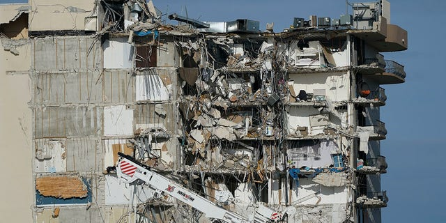 Heavy machinery sits parked outside the still standing section of the Champlain Towers South condo building, July 1, 2021, in Surfside, Florida. (Associated Press)