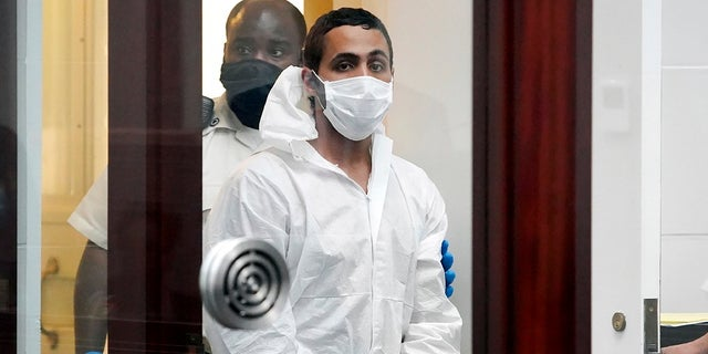 Khaled Awad is led into court while arraigned on charges in the stabbing of a rabbi near a Jewish day school, in Brighton District Court in Boston on Friday July.