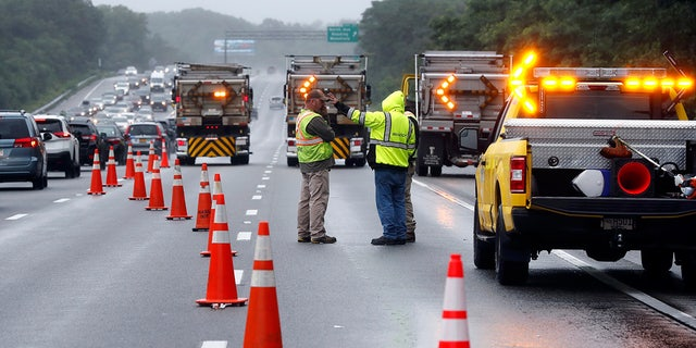Traffic on Interstate 95 is diverted in the area of an hours long standoff with a group of armed men that partially shut down the highway, Saturday, July 3, 2021, in Wakefield, Mass. Massachusetts state police say nine suspects have been taken into custody. (AP Photo/Michael Dwyer)