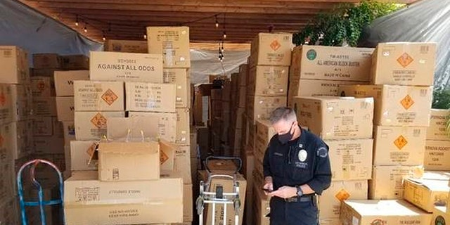 This July 2021 photo released by the ATF/United States Attorney's Office Central District of California, shows boxes of illegal large homemade fireworks explosives in South Los Angeles. Authorities found over 500 boxes of commercial grade fireworks in large cardboard boxes. (Associated Press)