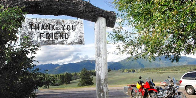 In this July 9, 2009, file photo, the Bob Marshall Wilderness cuts a jagged line across the horizon as patrons leave Trixi's Antler Saloon in Ovando, Mont.