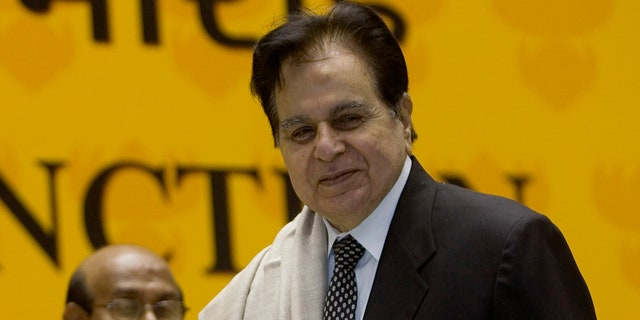 Veteran Bollywood actor Dilip Kumar, right, receives a Lifetime Achievement award at the 54th National Film Award ceremony in New Delhi, India on Sept. 2, 2008. (AP Photo/Gurinder Osan, File)