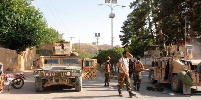 Afghan soldiers hold on to a street at the forefront of fighting between Taliban and security forces in Badghis province, northwest of Afghanistan, on Wednesday, July 7, 2021.