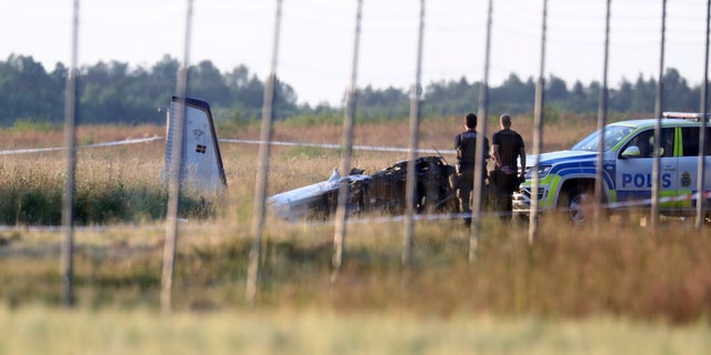 Rescue services at the site of a minor plane crash at Orebro Airport in Sweden, Thursday 8 July 2021. The plane was used by the local parachute club with nine people on board.  According to police, several fatalities were reported.  (Jeppe Gustafsson / TT News Agency via AP)