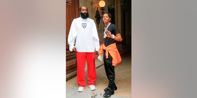 NBA player James Harden, left, and Lil 'Baby arrive at the Balenciaga Haute Couture Fall / Winter 2021/2022 as part of Paris Fashion Week on Wednesday July 7, 2021 in Paris.