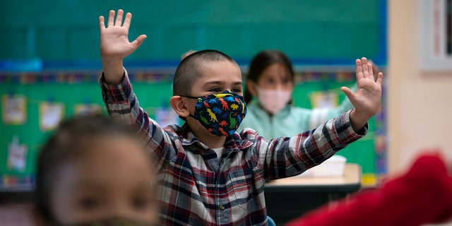 Kindergarten students participate in a class activity on the first day of personal learning at Maurice Sendak Elementary School in Los Angeles, April 13, 2021. (Associated Press)