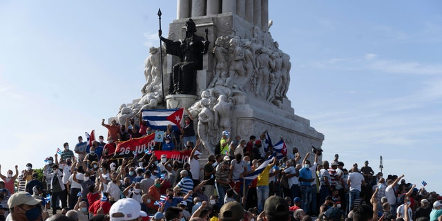 Anti-government protesters gather at the Maximo Gomez monument in Havana, Cuba, Sunday, July 11, 2021. Hundreds of demonstrators took to the streets in several cities in Cuba to protest against ongoing food shortages and high prices of foodstuffs.