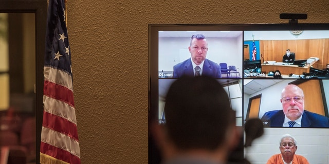 In this Thursday, April 15, 2021, file photo, defendants Paul Flores, top left, and his father, Ruben Flores, bottom right, appear via video conference during their arraignment in San Luis Obispo Superior Court in San Luis Obispo, Calif. (AP Photo/Nic Coury, File)