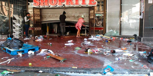 The trashed entrance to a supermarket in Durban South Africa, Thursday, July 15, 2021, as unrest continues in the KwaZulu Natal province.