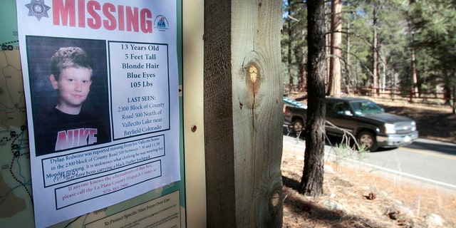 A missing poster of 13-year-old Dylan Redwine hangs on a trail head sign next to Vallecito Reservoir in Vallecito, Colorado, Nov. 26, 2012.